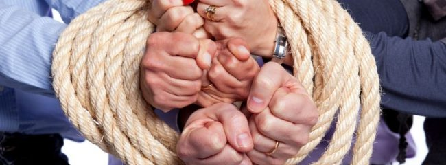 Employees hands tied with noncompete agreement