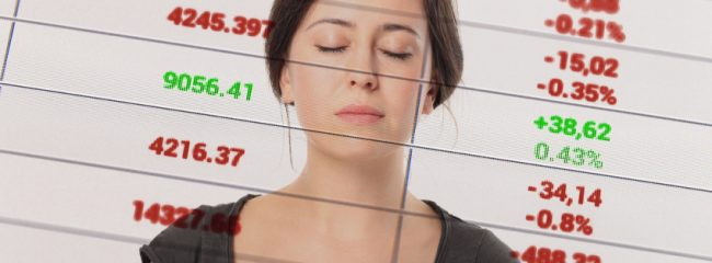 Woman with spreadsheet behind her